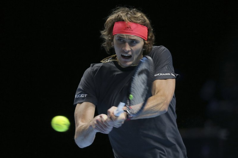 FILE - In this Nov. 17, 2018, file photo, Alexander Zverev of Germany plays a return to Roger Federer of Switzerland in their ATP World Tour Finals singles tennis match at O2 Arena in London. (AP Photo/Tim Ireland, File)
