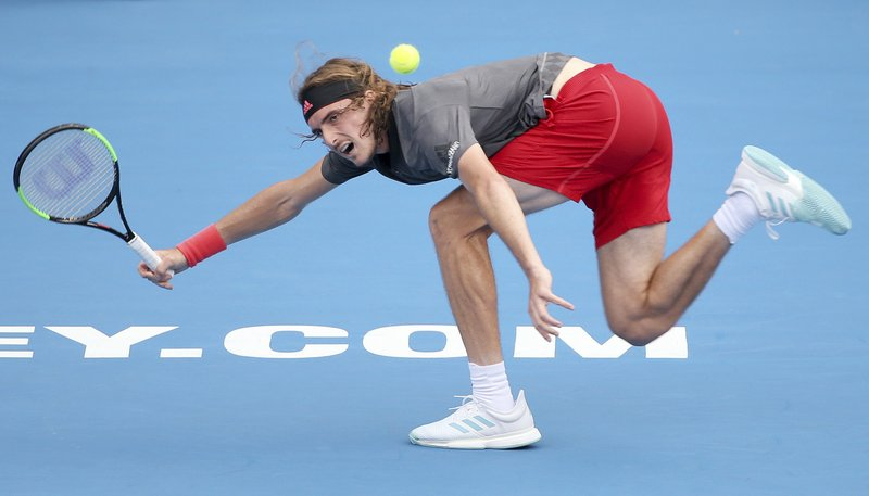 FILE - In this Jan. 9, 2019, file photo, Stefanos Tsitsipas of Greece plays a forehand to Guido Andreozzi of Argentina during their men's singles match at the Sydney International tennis tournament in Sydney, Australia. (AP Photo/Rick Rycroft, File)