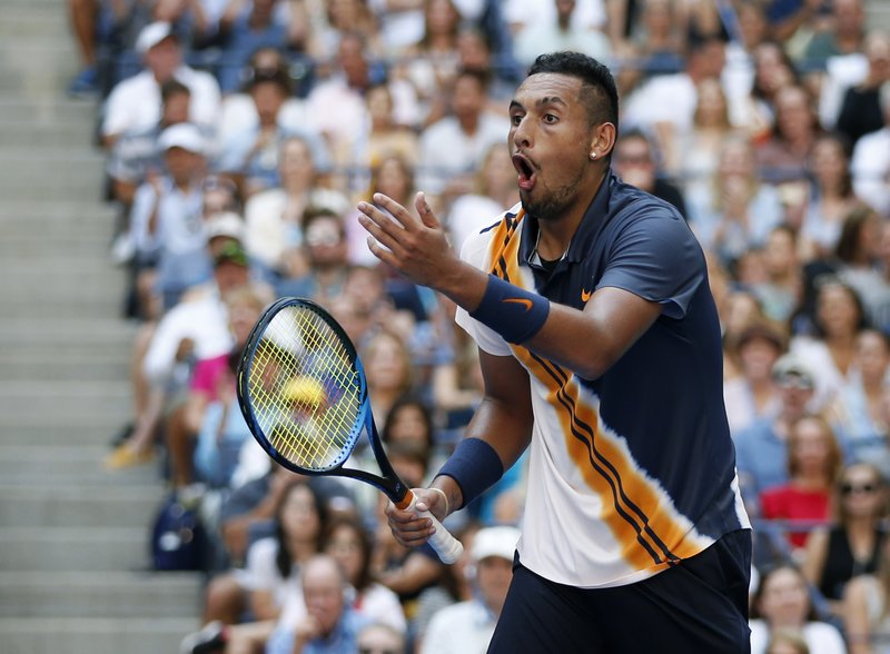 FILE - In this Sept. 1, 2018, file photo, Nick Kyrgios of Australia,reacts to a winning shot by by Roger Federer of Switzerland during the third round of the U. (AP Photo/Jason DeCrow, File)