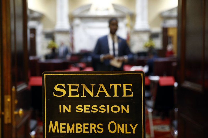 FILE - In this Wednesday, Jan. 9, 2019 file photo, a sign stands outside an entrance to the Maryland State Senate chamber in Annapolis, Md. (AP Photo/Patrick Semansky)