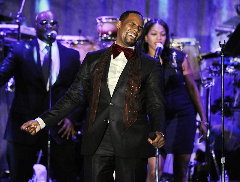 FILE - This Feb. 12, 2011 file photo shows R. Kelly performing at the pre-Grammy gala & salute to industry icons with Clive Davis honoring David Geffen in Beverly Hills, Calif. (AP Photo/Mark J. Terrill, file)