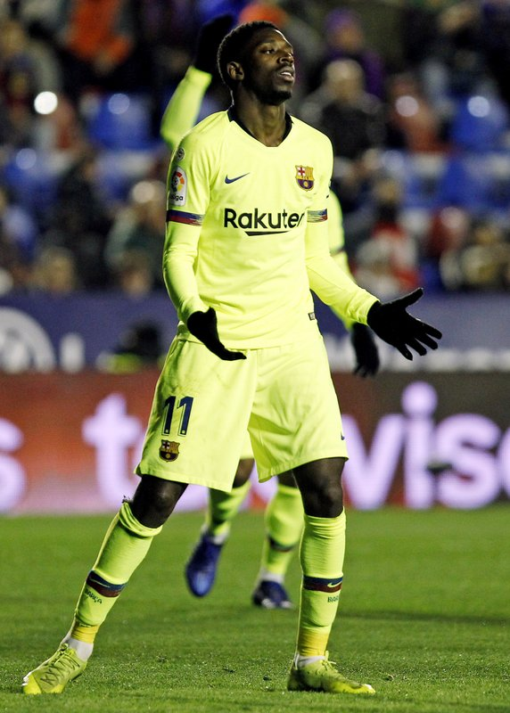 Barcelona forward Ousmane Dembele reacts after failing to score against Levante during the la Copa del Rey round of 16 first leg soccer match between Levante and Barcelona at the Ciutat de Valencia stadium in Valencia, Spain, Thursday Jan. (AP Photo/Alberto Saiz)