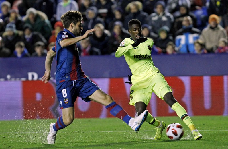 Barcelona forward Ousmane Dembele, right, duels for the ball with Levante midfielder Prcic during the la Copa del Rey round of 16 first leg soccer match between Levante and Barcelona at the Ciutat de Valencia stadium in Valencia, Spain, Thursday Jan. (AP Photo/Alberto Saiz)