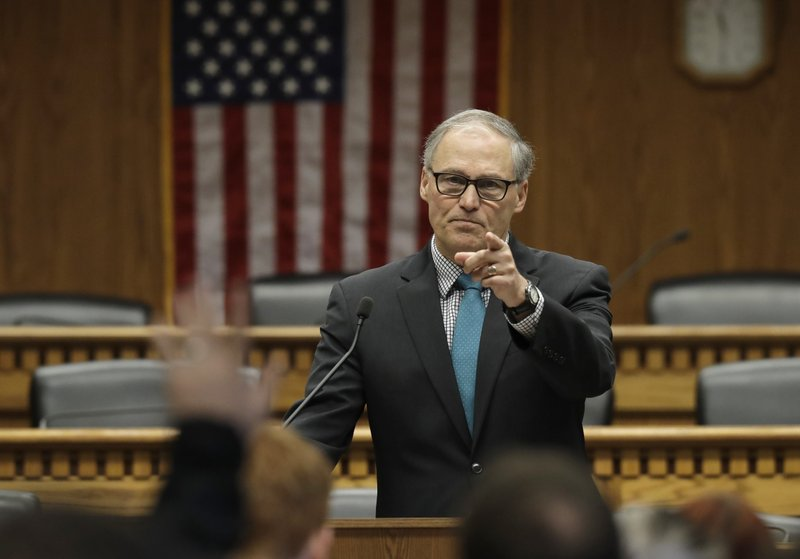Washington Gov. Jay Inslee takes questions from reporters following his speech at The Associated Press Legislative Preview, Thursday, Jan. (AP Photo/Ted S. Warren)
