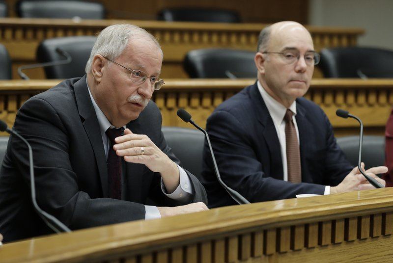 House Speaker Frank Chopp, D-Seattle, left, speaks as he sits next to Sen. Keith Wagoner, R-Sedro-Woolley, the ranking Republican on the Behavioral Health Subcommittee, as they take part in the Mental Health Reform Panel discussion during The Associated Press Legislative Preview, Thursday, Jan. (AP Photo/Ted S. Warren)