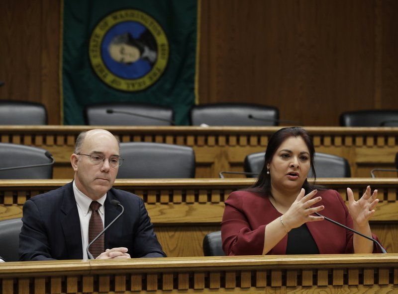 Sen. Manka Dhingra, D-Redmond, right, chairwoman of the Behavioral Health Subcommittee, speaks as she sits next to Sen. (AP Photo/Ted S. Warren)