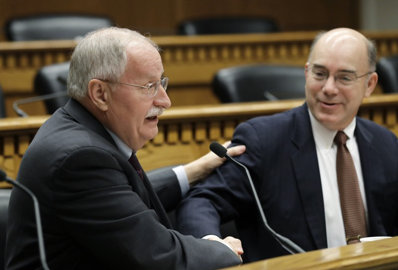 House Speaker Frank Chopp, D-Seattle, left, shakes hands with Sen. Keith Wagoner, R-Sedro-Woolley, the ranking Republican on the Behavioral Health Subcommittee, as they take part in the Mental Health Reform Panel discussion during the Associated Press Legislative Preview, Thursday, Jan. (AP Photo/Ted S. Warren)