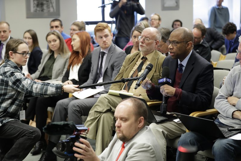 Essex Porter, right, of KIRO TV, asks a question during the Leadership Panel of the Associated Press Legislative Preview, Thursday, Jan. (AP Photo/Ted S. Warren)