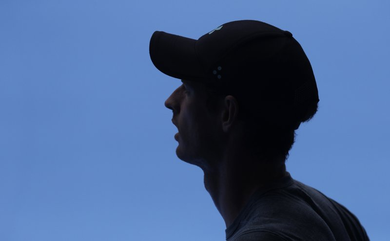 Britain's Andy Murray waits in the shade during his practice match against Serbia's Novak Djokovic on Margaret Court Arena ahead of the Australian Open tennis championships IN Melbourne, Australia, Thursday, Jan. (AP Photo/Mark Baker)