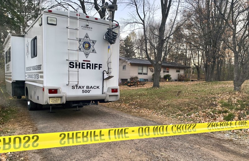 FILE - In this Oct. 23, 2018, file photo, a Barron County, Wis., sheriff's vehicle is parked outside the home where James Closs and Denise Closs were found fatally shot on Oct. (AP Photo/Jeff Baenen, File)