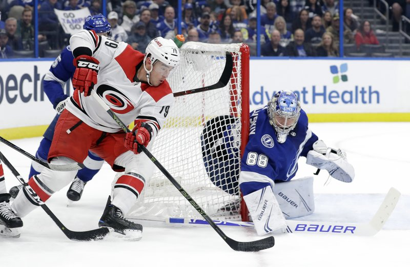 Carolina Hurricanes left wing Micheal Ferland (79) moves in for a shot on Tampa Bay Lightning goaltender Andrei Vasilevskiy (88) during the first period of an NHL hockey game Thursday, Jan. (AP Photo/Chris O'Meara)