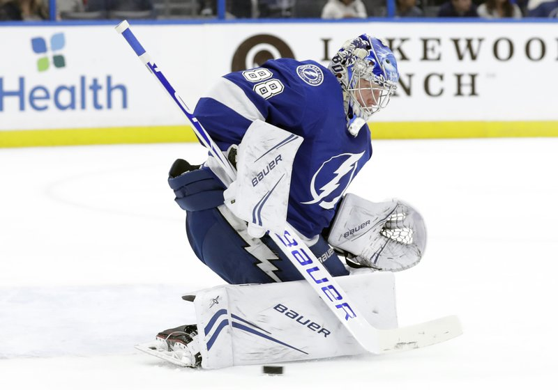 Tampa Bay Lightning goaltender Andrei Vasilevskiy makes a pad save on a shot by the Carolina Hurricanes during the first period of an NHL hockey game Thursday, Jan. (AP Photo/Chris O'Meara)