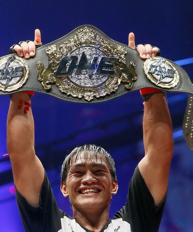 FILE - In this April 21, 2017, file photo, Philippines' Eduard Folayang raises his championship belt during an award ceremony after beating Malaysian-born Ev Ting in the lightweight Mixed Martial Arts title fight dubbed One FC (Fighting Championship), in Pasay city, south of Manila, Philippines. (AP Photo/Bullit Marquez, File)