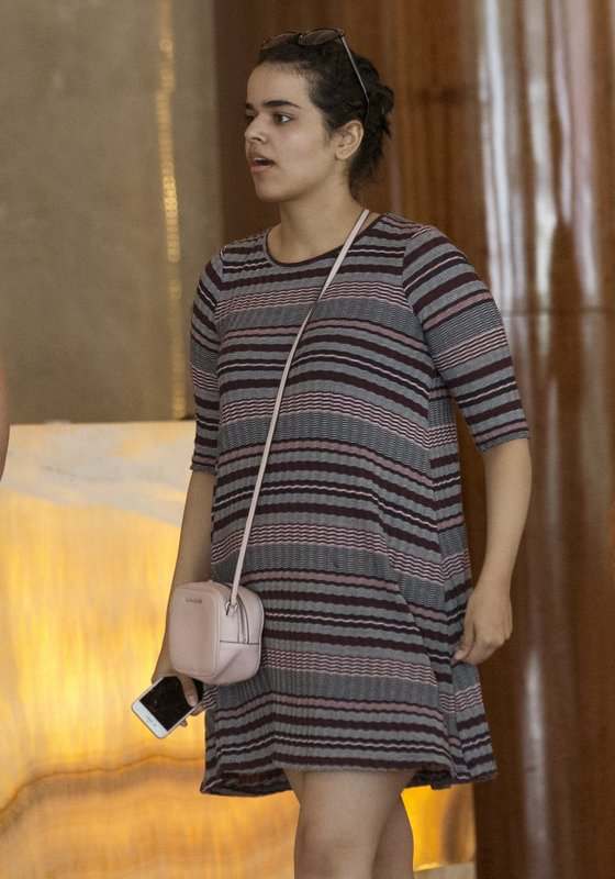 Rahaf Mohammed Alqunun holds a mobile phone in Bangkok, Thailand, Friday, Jan. 11, 2019. Alqunun, the 18-year old Saudi woman who fled her family to seek asylum, remains in Thailand under the care of the U. (AP Photo/Sakchai Lalit)