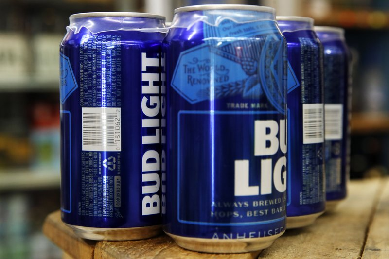 This Thursday, Jan. 10, 2019, photo shows cans of Bud Light in Washington. Starting next month, packages of Bud Light will have prominent labels showing the beer's ingredients and calories as well as the amount of fat, carbohydrates and protein in a serving. (AP Photo/Jacquelyn Martin)