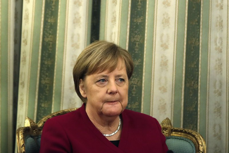 German Chancellor Angela Merkel is seen during a meeting with Greece's President Prokopis Pavlopoulos at the presidential palace in Athens, Friday, Jan. (AP Photo/Thanassis Stavrakis)