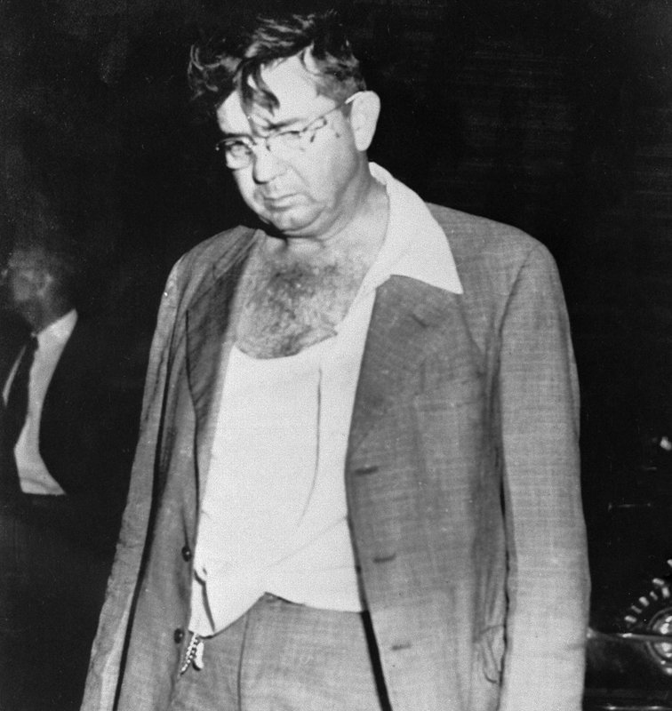 In this Nov. 7, 1951, file photo, Sheriff Willis McCall of Lake County, Fla., is shown after shooting two handcuffed black men, Samuel Shepherd and Walter Lee Irvin, whom he claimed were trying to escape as he transferred them from prison to a jail for a hearing prior to their re-trial for the rape of a 17-year-old white woman in 1949. (AP Photo, File)