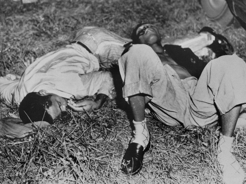 EDS NOTE: GRAPHIC CONTENT - In this Nov. 7, 1951, file photo, Samuel Shepherd, left, and Walter Lee Irvin, lie on the roadside near Umatilla, Fla. (AP Photo, File)