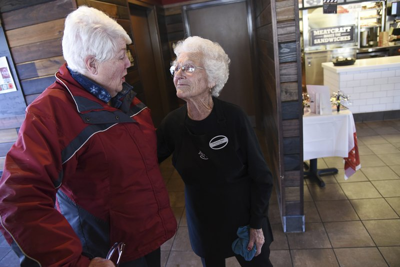 Spotting her car in the parking lot as an indication that her friend was working, Sharon Grover, left, stops in for a frosty drink and to say hi to Dorothy Bale who has been working at the same Arby's at at 2284 E. (Francisco Kjolseth/The Salt Lake Tribune via AP)