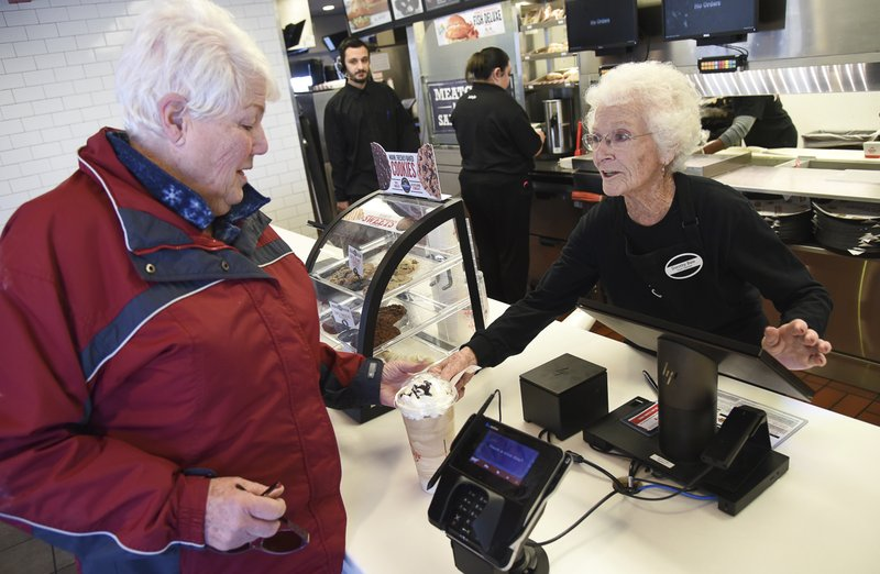 Sharon Grover orders a drink from her long time friend 94-year-old Dorothy Bale who after 25 years at Arby's in Millcreek, Utah, has no plans to retire from the job she started when she was 69. (Francisco Kjolseth/The Salt Lake Tribune via AP)