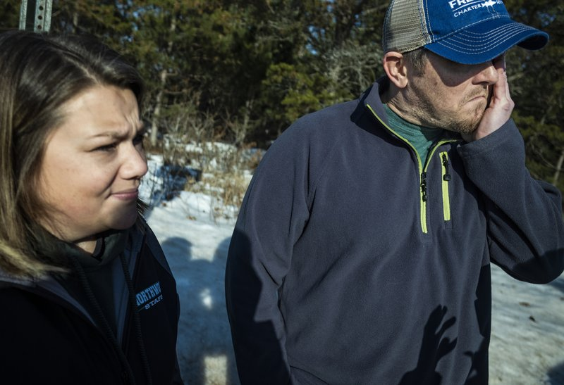 Kristin Kasinskas, who lives on S. Eau Claire Acres Circle with her husband, Peter, speak with the media Friday, Jan. (Richard Tsong-Taatarii/Star Tribune via AP)