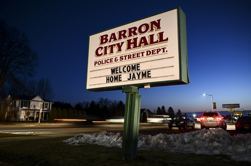 The sign outside Barron, Wis., City Hall, Friday, Jan. 11, 2019, welcomes Jayme Closs, a 13-year-old northwestern Wisconsin girl who went missing in October after her parents were killed. (Aaron Lavinsky/Star Tribune via AP)