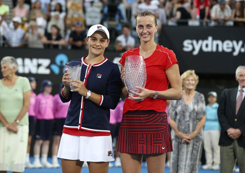 Petra Kvitova of the Czech Republic, right, holds the winner's trophy as she poses for photographers with runner up Ashleigh Barty of Australia after their women's final match at the Sydney International tennis tournament in Sydney, Australia, Saturday, Jan. (AP Photo/David Moir)