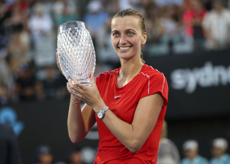 Petra Kvitova of the Czech Republic holds the winners trophy after beating Ashleigh Barty of Australia after their women's final match at the Sydney International tennis tournament in Sydney, Australia, Saturday, Jan. (AP Photo/David Moir)