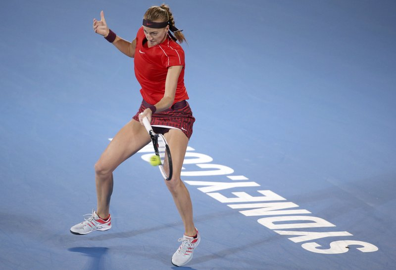Petra Kvitova of Czech Republic hits a forehand to Aliaksandra Sasnovich of Belarus during their women's singles semifinal match at the Sydney International tennis tournament in Sydney, Saturday, Jan. (AP Photo/Rick Rycroft)