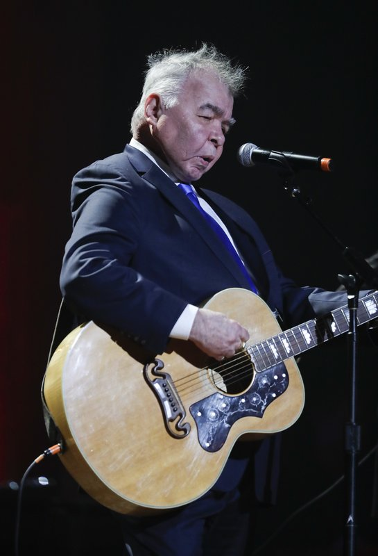 FILE - In this Wednesday, Sept. 13, 2017 file photo, John Prine performs during the Americana Honors and Awards show in Nashville, Tenn. (AP Photo/Mark Zaleski, File)