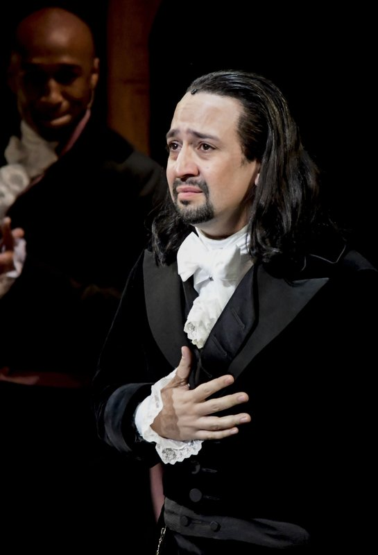 Lin-Manuel Miranda, composer and creator of the award-winning Broadway musical, Hamilton, receives a standing ovation with tears at the ending of the play's premiere held at the Santurce Fine Arts Center, in San Juan, Puerto Rico, Friday, Jan. (AP Photo/Carlos Giusti)