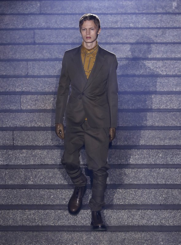 A model wears a creation as part of the Ermenegildo Zegna men's Fall-Winter 2019-20 collection, unveiled during the Fashion Week in Milan, Italy, Friday, Jan. (AP Photo/Antonio Calanni)