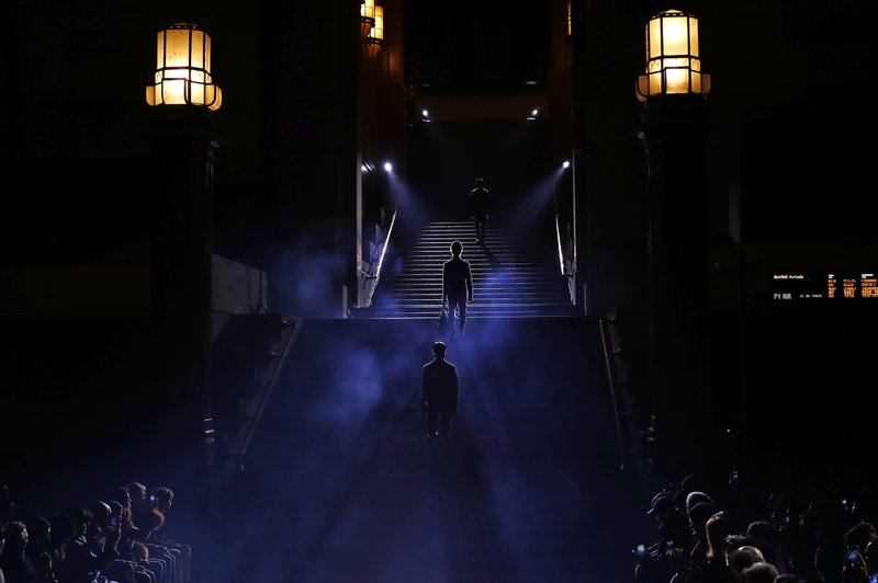 Models wear creations as part of the Ermenegildo Zegna men's Fall-Winter 2019-20 collection, unveiled during the Fashion Week in Milan, Italy, Friday, Jan. (AP Photo/Antonio Calanni)