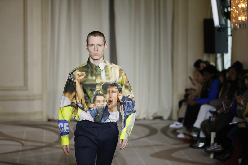 A model wears a creation as part of the M1992 men's Fall-Winter 2019-20 collection, that was presented in Milan, Italy, Saturday, Jan. (AP Photo/Antonio Calanni)