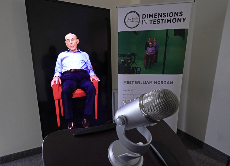 A Dimensions in Testimony exhibit featuring Holocaust survivor William Morgan using an interactive virtual conversation is shown at the the Holocaust Museum Houston Friday, Jan. (AP Photo/David J. Phillip)