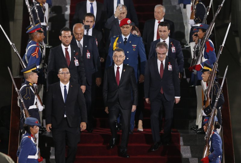 Turkey's Vice President Fuat Oktay arrives to the Supreme Court for the swearing-in ceremony of Venezuelan President Nicolas Maduro in Caracas, Venezuela, Thursday, Jan. (AP Photo/Ariana Cubillos)