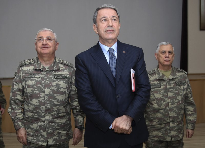 Turkey's Defence Minister Hulusi Akar listens during a meeting with the commanders of military units on Syrian border in Sanliurfa, southeastern Turkey, Friday, Jan. (Turkish Defence Ministry via AP)