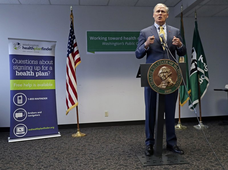 FILE - In this Tuesday, Jan. 8, 2019, file photo, Washington Gov. Jay Inslee answers questions from reporters at a news conference in Seattle. (AP Photo/Ted S. Warren, File)