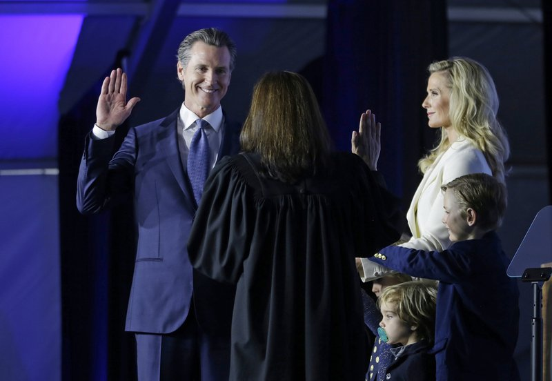 FILE - In this Jan. 7, 2019, file photo, California Governor Gavin Newsom takes the oath of office from state Supreme Court Chief Justice Tani Gorre Cantil-Sakauye during his inauguration in Sacramento, Calif. (AP Photo/Rich Pedroncelli, File)
