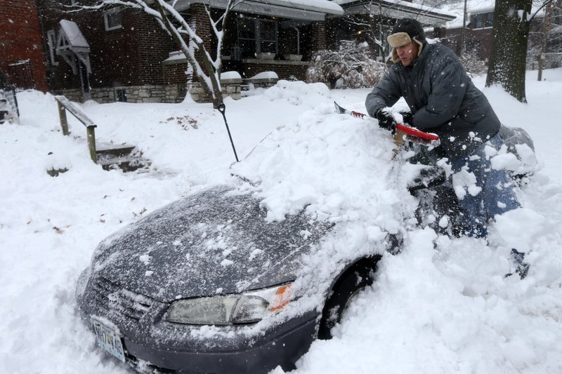Jeff Clifford digs out his girlfriend's car from a pile of snow on Saturday, Jan. 12, 2019, in St. Louis. (Laurie Skrivan/St. Louis Post-Dispatch via AP)