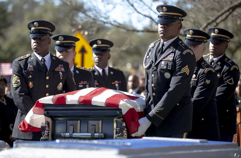An honor guard walks with the casket of WWII veteran Richard Overton during a burial ceremony at the Texas State Cemetery on Saturday, Jan. (Nick Wagner/Austin American-Statesman via AP)