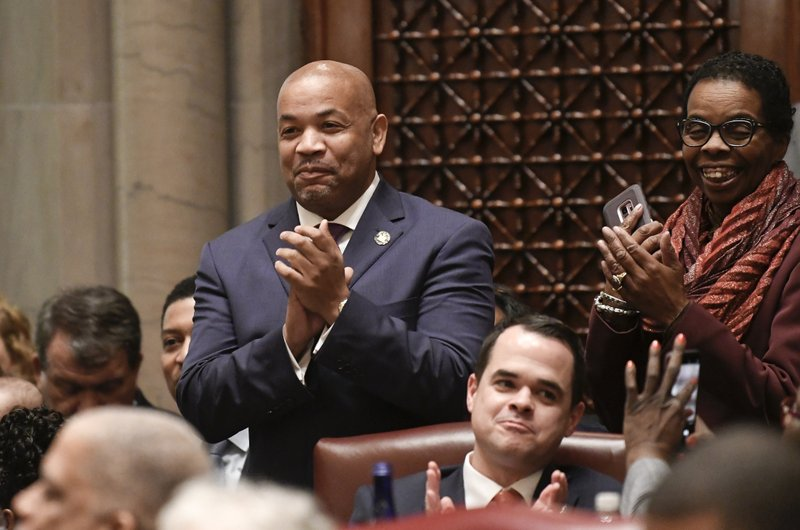 FILE - In this Jan. 9, 2019 file photo, Assembly Speaker Carl Heastie, D-Bronx, left, and others applaud while listening to Senate Majority Leader Andrea Stewart-Cousins, D-Yonkers during opening day of the legislative session in Albany, N. (AP Photo/Hans Pennink, File)