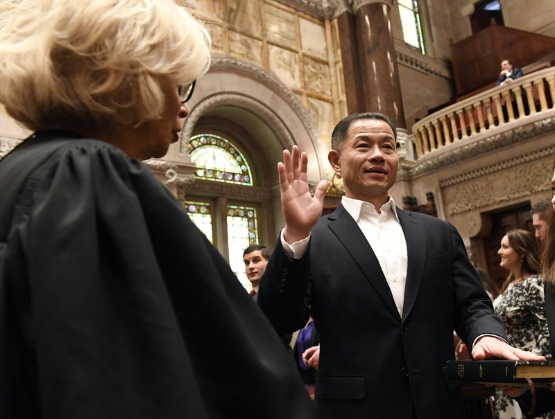 FILE - In this Jan. 9, 2019 file photo, New York Court of Appeals Chief Judge Janet DiFiore, left, administers the oath of office to John Liu, D-Queens, during opening day of the legislative session in Albany, N. (AP Photo/Hans Pennink, File)