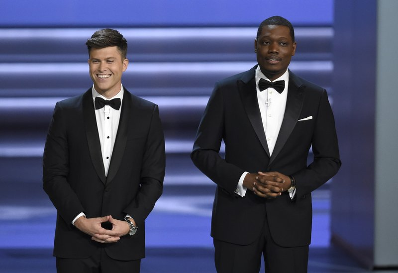 FILE - In this Sept. 18, 2018 file photo, hosts Colin Jost, left, and Michael Che speak at the 70th Primetime Emmy Awards at the Microsoft Theater in Los Angeles. (Photo by Chris Pizzello/Invision/AP, File)
