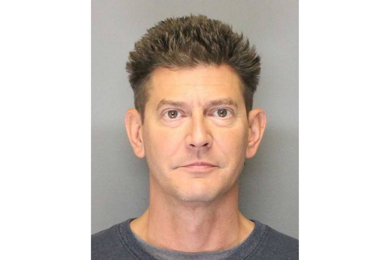 This 2018 booking photo released by the Yolo County Sheriff's Office shows Kevin Douglas Limbaugh. Authorities identified the 48-year-old Limbaugh as the man who shot and killed Davis, Calif. (Yolo County Sheriff's Office via AP)