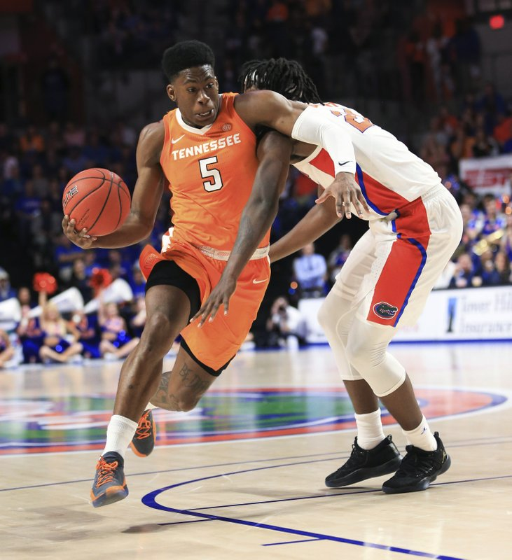 Tennessee guard Admiral Schofield (5) drives past Florida forward Dontay Bassett (21) during the first half of an NCAA college basketball game Saturday, Jan. (AP Photo/Matt Stamey)