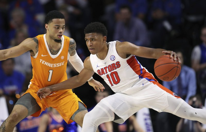 Florida guard Noah Locke (10) is defended by Tennessee guard Lamonte Turner (1) during the first half of an NCAA college basketball game Saturday, Jan. (AP Photo/Matt Stamey)