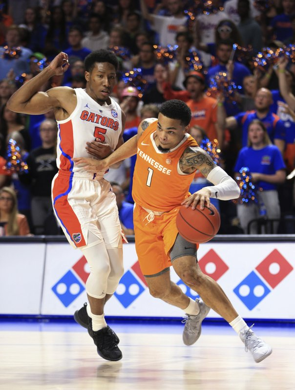 Tennessee guard Lamonte Turner (1) drives past Florida guard KeVaughn Allen (5) during the first half of an NCAA college basketball game Saturday, Jan. (AP Photo/Matt Stamey)