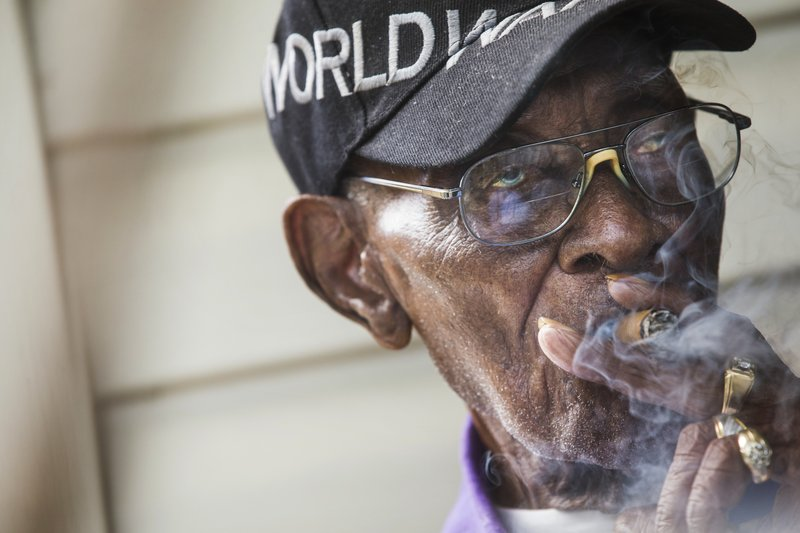 FILE - In this May 10, 2018 file photo, Richard Overton, America's oldest living WWII veteran, sits on his porch in Austin, Texas. (Amanda Voisard/Austin American-Statesman via AP)