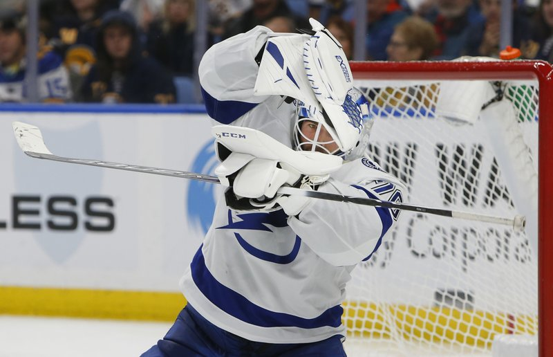 Tampa Bay Lightning goalie Louis Domingue makes a glove save during the third period of the team's NHL hockey game against the Buffalo Sabres, Saturday, Jan. (AP Photo/Jeffrey T. Barnes)